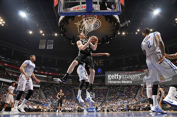 Aron Baynes of the San Antonio Spurs shoots against the Orlando Magic on April 1 2015 at Amway Center in Orlando Florida NOTE TO USER User expressly...