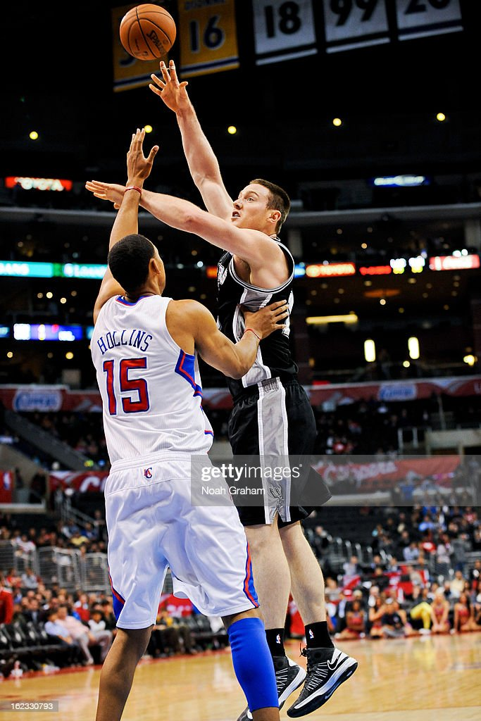 Aron Baynes #16 of the San Antonio Spurs shoots in the lane against <a gi-track='captionPersonalityLinkClicked' href=/galleries/search?phrase=Ryan+Hollins&family=editorial&specificpeople=182556 ng-click='$event.stopPropagation()'>Ryan Hollins</a> #15 of the Los Angeles Clippers at Staples Center on February 21, 2013 in Los Angeles, California.