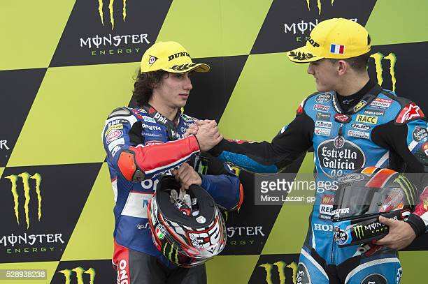 Aron Canet of Spain and Estrella Galicia 00 celebrates with Niccolo Antonelli of Italy and Ongetta Rivacold at the end of the qualifying practice...