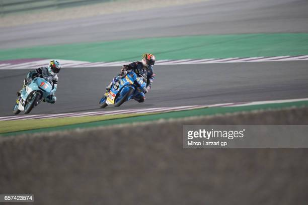 Aron Canet of Spain and Estrella Galicia 00 leads Andrea Migno of Italy and Sky Racing Team VR46 during the MotoGp of Qatar Free Practice at Losail...