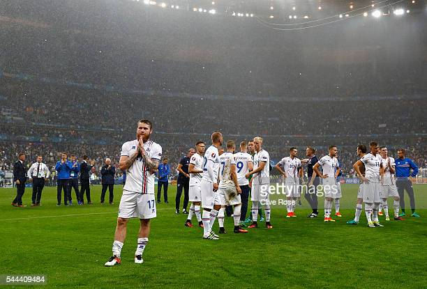 Aron Gunnarsson and Iceland players applaud their supporters after the UEFA EURO 2016 quarter final match between France and Iceland at Stade de...
