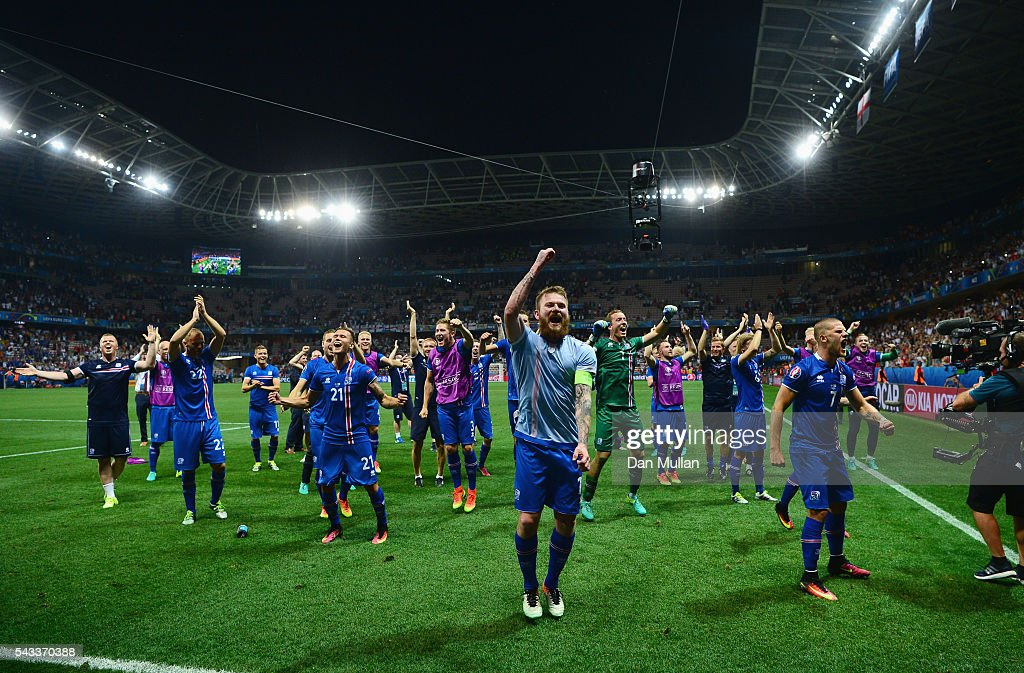 <a gi-track='captionPersonalityLinkClicked' href=/galleries/search?phrase=Aron+Gunnarsson&family=editorial&specificpeople=5490377 ng-click='$event.stopPropagation()'>Aron Gunnarsson</a> (C) and Iceland players celebrate their team's 2-1 win with supporters after the UEFA EURO 2016 round of 16 match between England and Iceland at Allianz Riviera Stadium on June 27, 2016 in Nice, France.