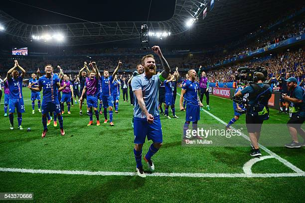 Aron Gunnarsson and Iceland players celebrate their team's 21 win with supporters after the UEFA EURO 2016 round of 16 match between England and...