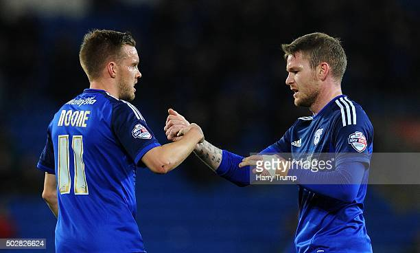 Aron Gunnarsson of Cardiff City celebrates his sides first goal with Craig Noone of Cardiff City during the Sky Bet Championship match between...