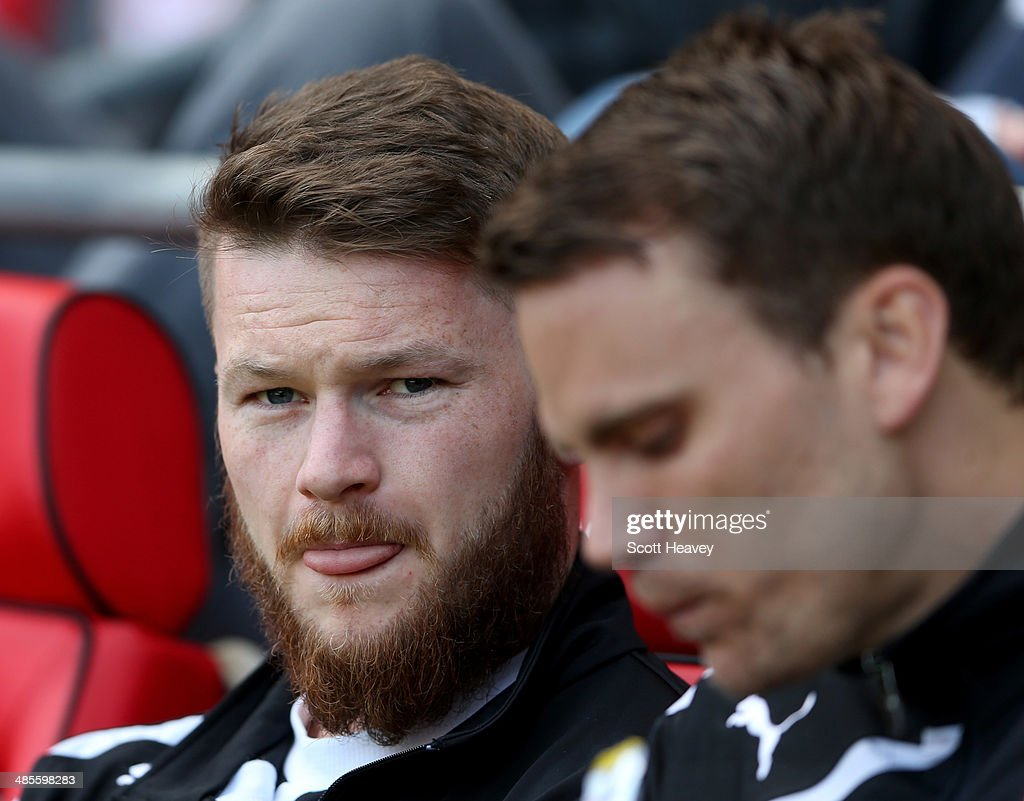 Aron Gunnarsson of Cardiff City (L) looks on from the bench prior to the Barclays Premier League match between Cardiff City and Stoke City at Cardiff City Stadium on April 19, 2014 in Cardiff, Wales.
