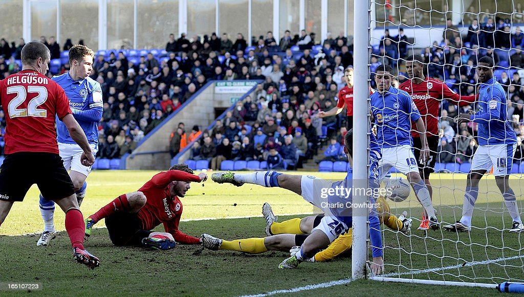Aron Gunnarsson of Cardiff City scores the first goal of the game during the npower Championship match between Peterborough United and Cardiff City at London Road on March 30, 2013 in Peterborough, England,