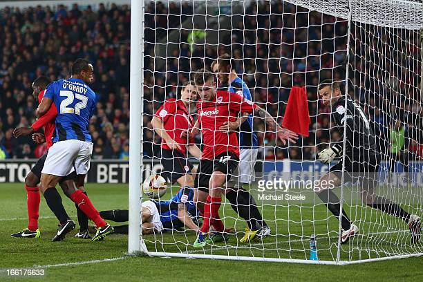 Aron Gunnarsson of Cardiff City watches the ball spin into the goal after Ben Turner of Cardiff City scores his sides opening goal during the npower...