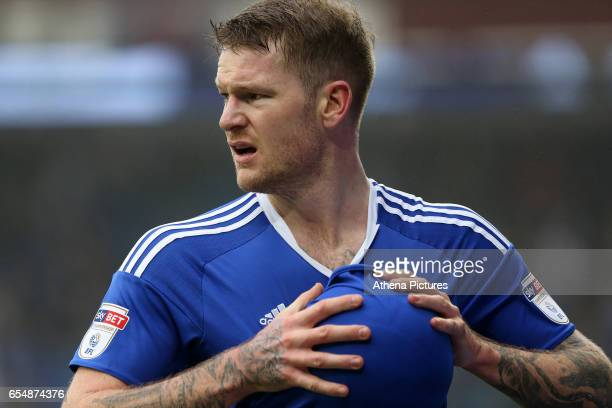 Aron Gunnarsson of Cardiff City wipes down a ball with his shirt before taking a throw in during the Sky Bet Championship match between Cardiff City...