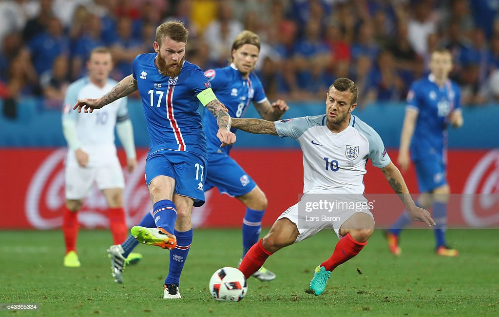 <a gi-track='captionPersonalityLinkClicked' href=/galleries/search?phrase=Aron+Gunnarsson&family=editorial&specificpeople=5490377 ng-click='$event.stopPropagation()'>Aron Gunnarsson</a> of Iceland and Jack Wilshire of England compete for the ball during the UEFA EURO 2016 round of 16 match between England and Iceland at Allianz Riviera Stadium on June 27, 2016 in Nice, France.