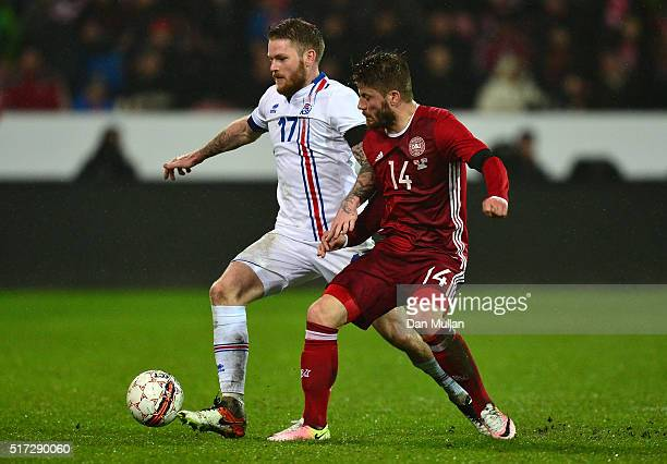 Aron Gunnarsson of Iceland battles for the ball with Lasse Schoene of Denmark during the International Friendly match between Denmark and Iceland at...
