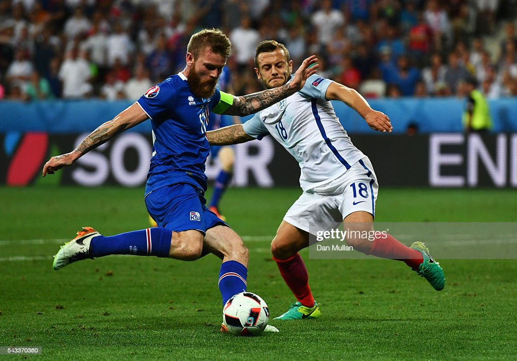 <a gi-track='captionPersonalityLinkClicked' href=/galleries/search?phrase=Aron+Gunnarsson&family=editorial&specificpeople=5490377 ng-click='$event.stopPropagation()'>Aron Gunnarsson</a> of Iceland shoots at goal while Jack Wilshire of England tries to block during the UEFA EURO 2016 round of 16 match between England and Iceland at Allianz Riviera Stadium on June 27, 2016 in Nice, France.