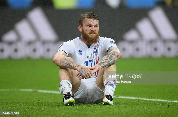 Aron Gunnarsson of Iceland shows his dejection after his team's 25 defeat in the UEFA EURO 2016 quarter final match between France and Iceland at...