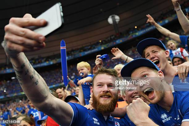 Aron Gunnarsson of Iceland takes a selfie photographs with supporters to celebrate his team's 21 win after the UEFA EURO 2016 Group F match between...
