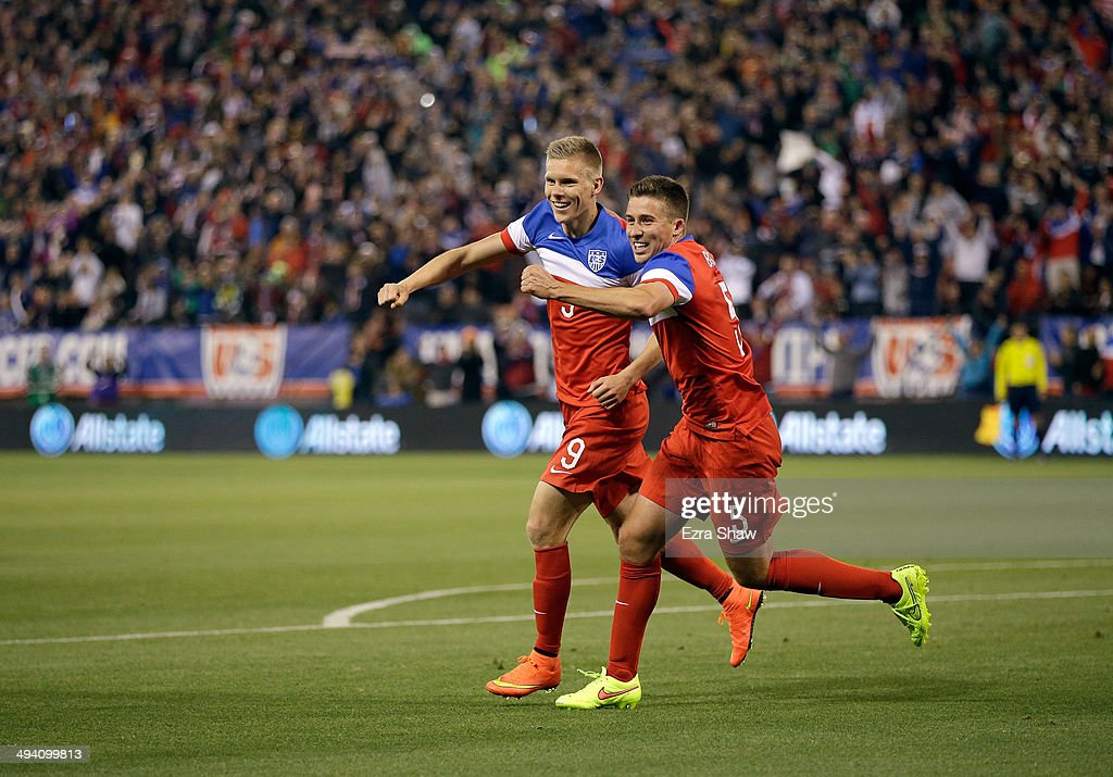 Aron Johannsson #9 and <a gi-track='captionPersonalityLinkClicked' href=/galleries/search?phrase=Matt+Besler&family=editorial&specificpeople=5664004 ng-click='$event.stopPropagation()'>Matt Besler</a> #5 of the United States celebrare after Johannsson scored a goal against Azerbaijan during their match at Candlestick Park on May 27, 2014 in San Francisco, California.