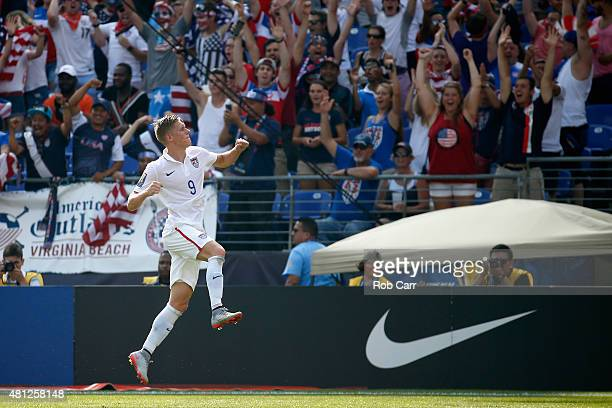 Aron Johannsson celebrates after scoring a first half goal against Cuba during the 2015 CONCACAF Gold Cup quarterfinal match at MT Bank Stadium on...