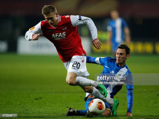 Aron Johannsson of AZ is tackled by Serhiy Rybalka of Slovan Liberec during the UEFA Europa League Round of 32 match between AZ Alkmaar and FC Slovan...