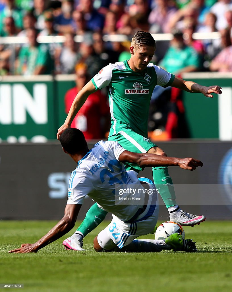 Aron Johannsson (L) of Bremen and Joel Matip of Schalke battle for the ball during the Bundesliga match between SV Werder Bremen and Schalke 04 at Weserstadion on August 15, 2015 in Bremen, Germany.