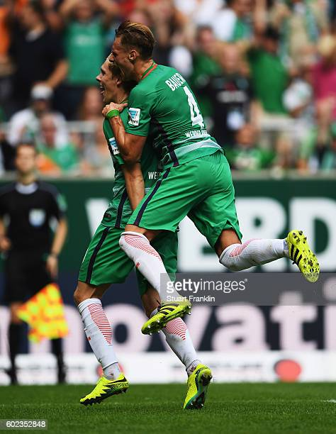 Aron Johannsson of Bremen celebrates scoring his goal with Robert Bauer during the Bundesliga match between Werder Bremen and FC Augsburg at...
