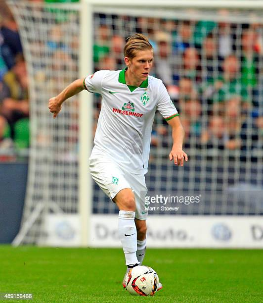Aron Johannsson of Bremen plays the ball during the Bundesliga match between Werder Bremen and FC Ingolstadt at Weserstadion on September 19 2015 in...