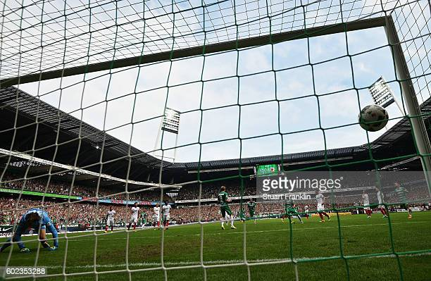 Aron Johannsson of Bremen scores his goal during the Bundesliga match between Werder Bremen and FC Augsburg at Weserstadion on September 11 2016 in...