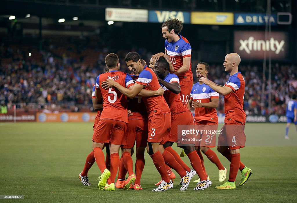 Aron Johannsson #9 of the United States is congratulated by teammates including Mix Diskerud #10 after he scored a goal against Azerbaijan during their match at Candlestick Park on May 27, 2014 in San Francisco, California.