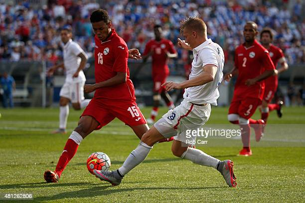 Aron Johannsson of USA moves the ball in front o Adrian Arturo Diz Pe of Cuba in the second half of USA's 60 win during the 2015 CONCACAF Gold Cup...