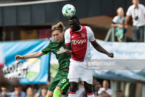 Aron Johansson of SV Werder Bremen Davinson Sanchez of Ajax during the friendly match between Ajax Amsterdam and SV Werder Bremen at Lindenstadion on...