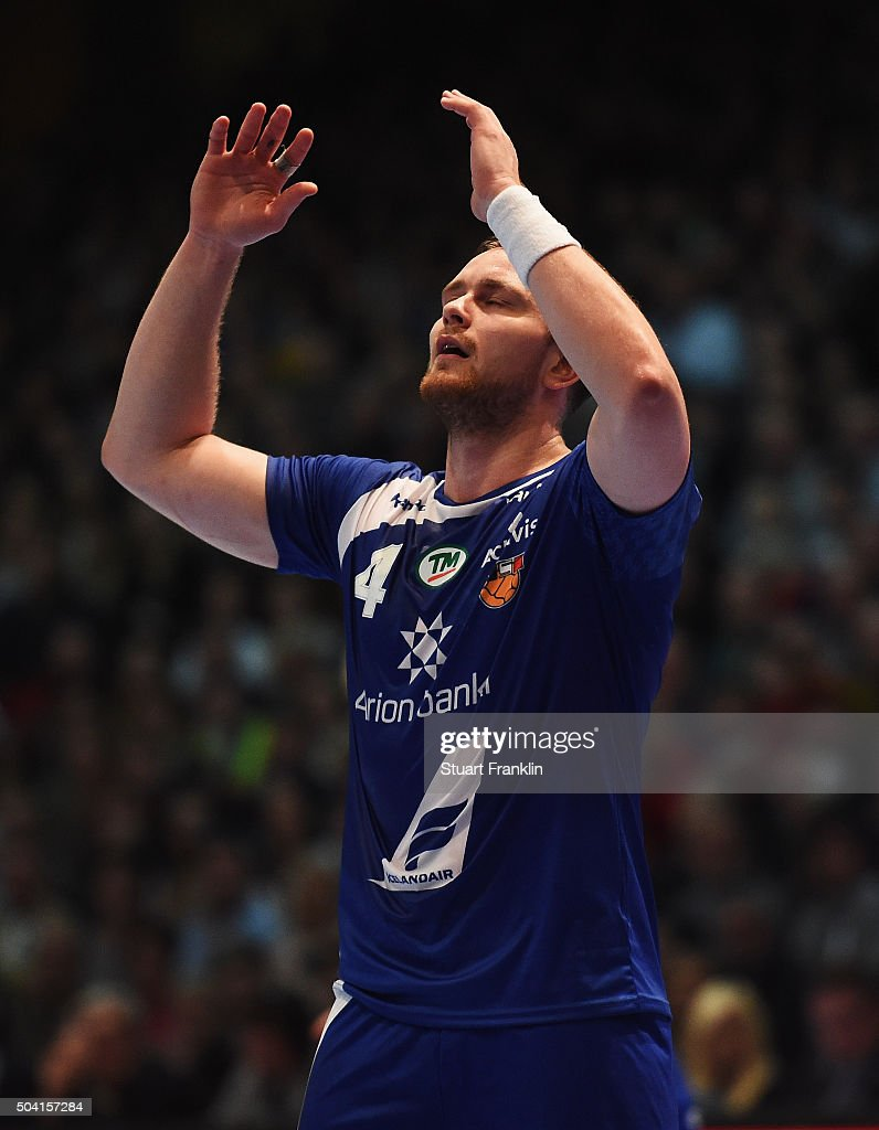 <a gi-track='captionPersonalityLinkClicked' href=/galleries/search?phrase=Aron+Palmarsson&family=editorial&specificpeople=5766529 ng-click='$event.stopPropagation()'>Aron Palmarsson</a> of Iceland reacts during the international handball friendly match between Germany and Iceland on January 9, 2016 in Kassel, Germany.