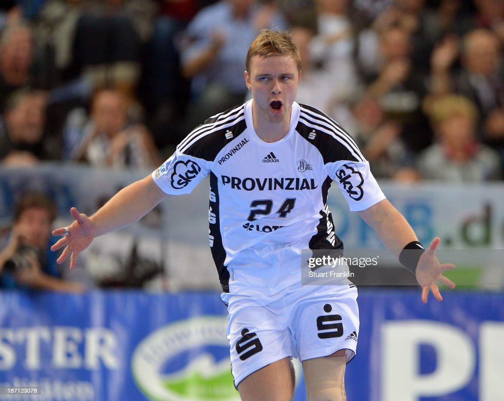 <a gi-track='captionPersonalityLinkClicked' href=/galleries/search?phrase=Aron+Palmarsson&family=editorial&specificpeople=5766529 ng-click='$event.stopPropagation()'>Aron Palmarsson</a> of Kiel celebratres during the Bundesliga handball match between THW Kiel and Rhein Neckar Loewen at the Sparkasse arena on November 6, 2013 in Kiel, Germany.