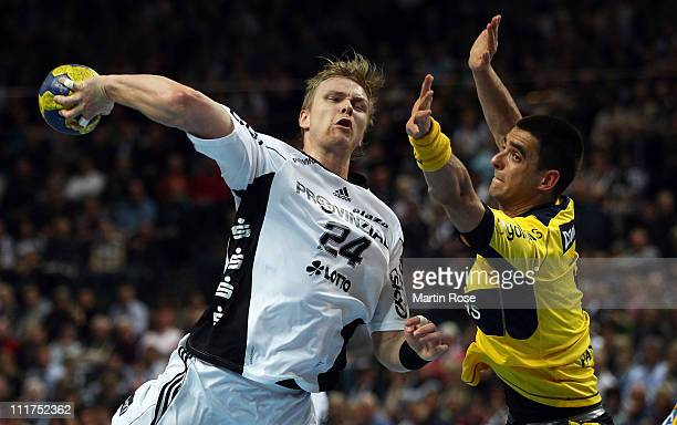 Aron Palmarsson of Kiel is challenged by Zarko Sesum of RheinNeckar during the Toyota Handball Bundesliga match between THW Kiel and RheinNeckar...