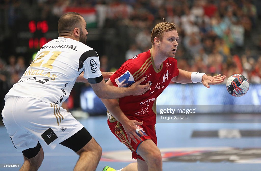 Aron Palmarsson of Veszprem (R) controls the ball beside Joan Canellas of Kiel during the second semi-final of the EHF Final4 between THW Kiel and MVM Veszprem on May 28, 2016 in Cologne, Germany.
