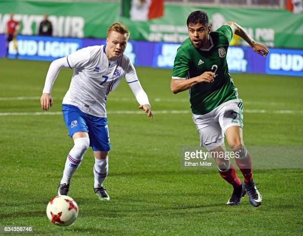 Aron Sigurdarson of Iceland and Nestor Araujo of Mexico go after the ball during their exhibition match at Sam Boyd Stadium on February 8 2017 in Las...