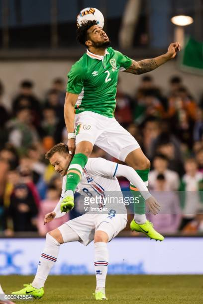 Aron Sigurdarson of Iceland Cyrus Christie of Irelandduring the friendly match between Ireland and Iceland on March 28 2017 at the Aviva stadium in...
