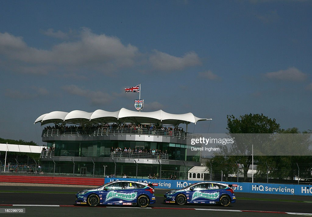 Aron Smith of Ireland drives the #8 Airwaves Racing Ford Focus ahead of team mate Mat Jackson during the Dunlop MSA British Touring Car Championship race at the Silverstone Circuit on September 28, 2013 in Towcester, United Kingdom.