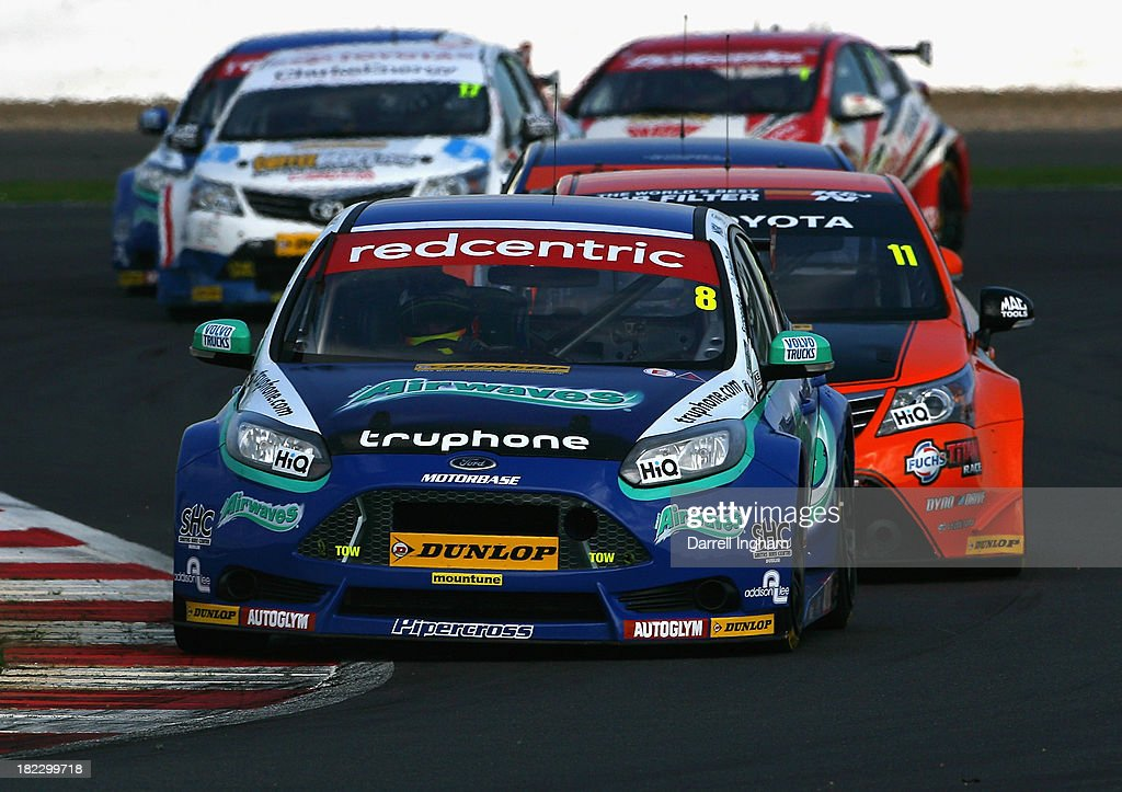 Aron Smith of Ireland drives the #8 Airwaves Racing Ford Focus during the Dunlop MSA British Touring Car Championship race at the Silverstone Circuit on September 28, 2013 in Towcester, United Kingdom.