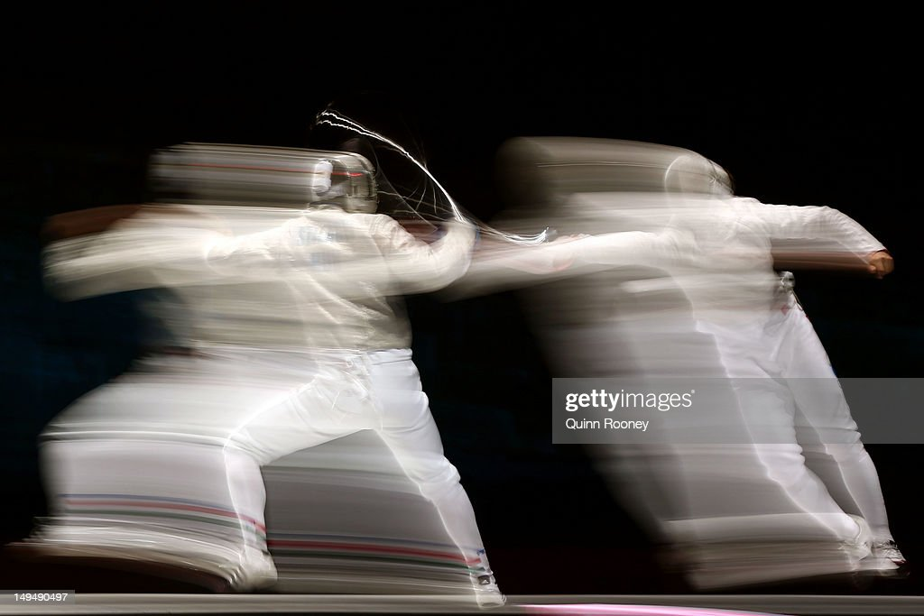 Aron Szilagyi (L) of Hungary competes against Nikolay Kovalev of Russia during their Men's Sabre Individual semifinal match on Day 2 of the London 2012 Olympic Games at ExCeL on July 29, 2012 in London, England.
