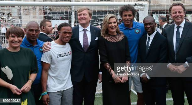 Aron Winter Edgar Davids King WillemAlexander of the Netherlands Queen Maxima of the Netherlands Pierre van Hooijdonk and Clarence Seedorf attend a...
