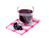 Aronia juice (Aronia melanocarpa) In a glass of isolated white background