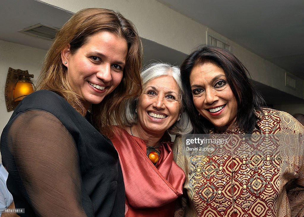 Aroon Shivdasani(C) and <a gi-track='captionPersonalityLinkClicked' href=/galleries/search?phrase=Mira+Nair&family=editorial&specificpeople=214181 ng-click='$event.stopPropagation()'>Mira Nair</a>(R) attend the after party following 'The Reluctant Fundamentalist' screening during the 2013 New York Indian Film Festival at Yuva on April 24, 2013 in New York City.