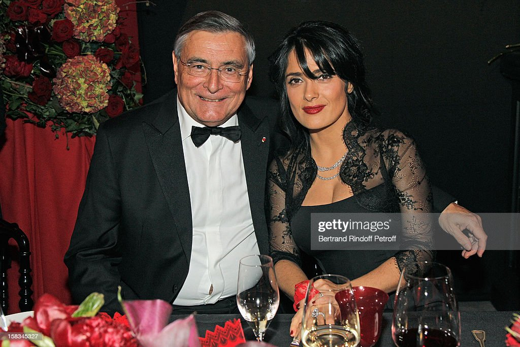 Arop President Jean-Louis Beffa (L) and President of the Arop Gala evening, actress Salma Hayek, attend the Arop Gala event for Carmen new production launch at Opera Bastille on December 13, 2012 in Paris, France.