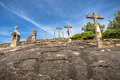 Calvary of Arouca, set of crosses and pulpit built in a rocky mass, with a background of blue sky.