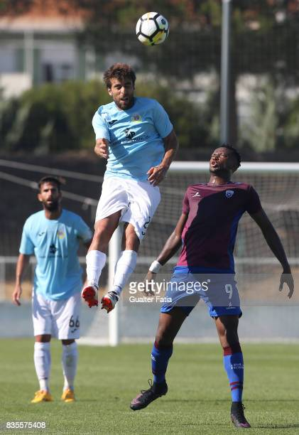 Arouca midfielder Andre Santos from Portugal with CD Cova da Piedade forward Ifeanyi Onyilo from Nigeria in action during the Segunda Liga match...