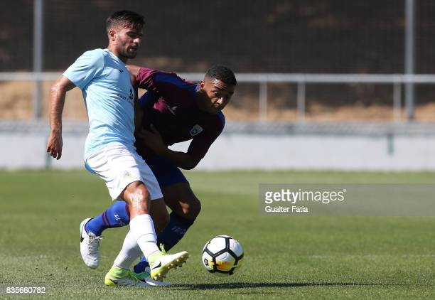 Arouca midfielder Nuno Valente from Portugal with CD Cova da Piedade midfielder Soares from Brazil in action during the Segunda Liga match between CD...