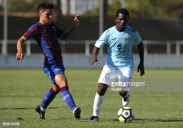 Arouca midfielder Yaw Moses from Gana with CD Cova da Piedade midfielder Robson from Brazil in action during the Segunda Liga match between CD Cova...