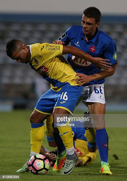 AroucaÕs defender from Brazil Thiago Carleto with Belenenses's midfielder Joao Palhinha from Portugal in action during the Primeira Liga match...