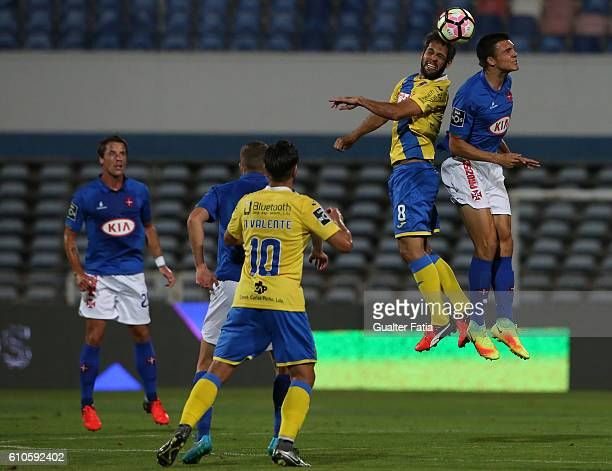AroucaÕs midfielder from Brazil Adilson Tavares with Belenenses's midfielder Joao Palhinha from Portugal in action during the Primeira Liga match...