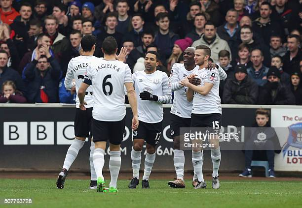 Arouna Kone of Everton celebrates scoring the opening goal with team mates during the Emirates FA Cup Fourth Round match between Carlisle United and...