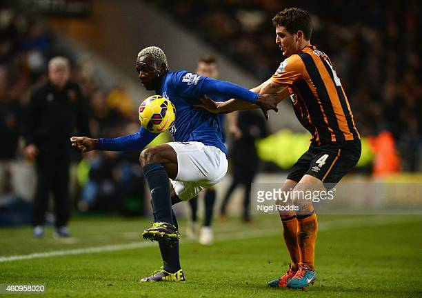 Arouna Kone of Everton is closed down by Alex Bruce of Hull City during the Barclays Premier League match between Hull City and Everton at KC Stadium...