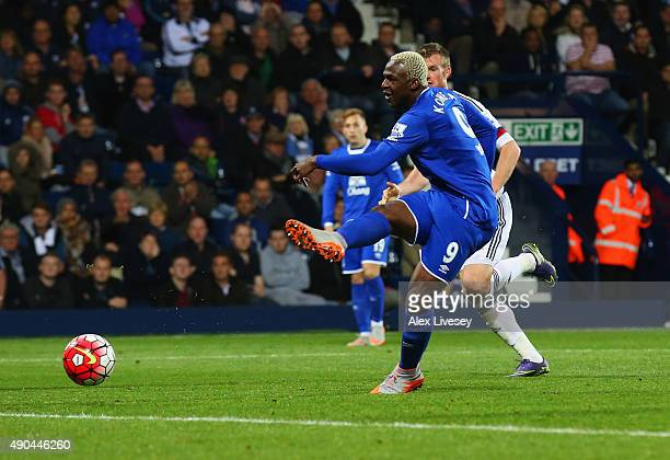 Arouna Kone of Everton scores their second and equalising goal during the Barclays Premier League match between West Bromwich Albion and Everton at...