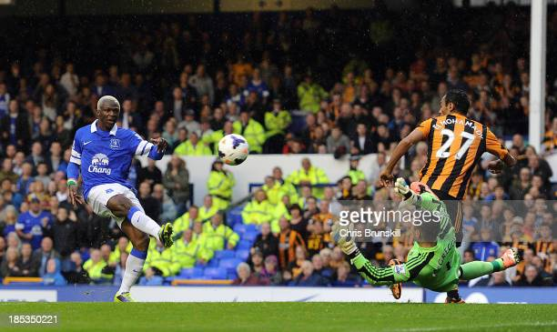 Arouna Kone of Everton shoots at goal as Allan McGregor of Hull City attempts to save during the Barclays Premier League match between Everton and...